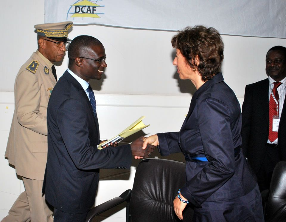 H.E. Muriel Berset Kohen, Ambassador of Switzerland to Senegal, greets Mr. Demba Diouf, Director of Cabinet of the Minister of Armed Forces of Senegal, during the Dakar Regional Conference, June 2014